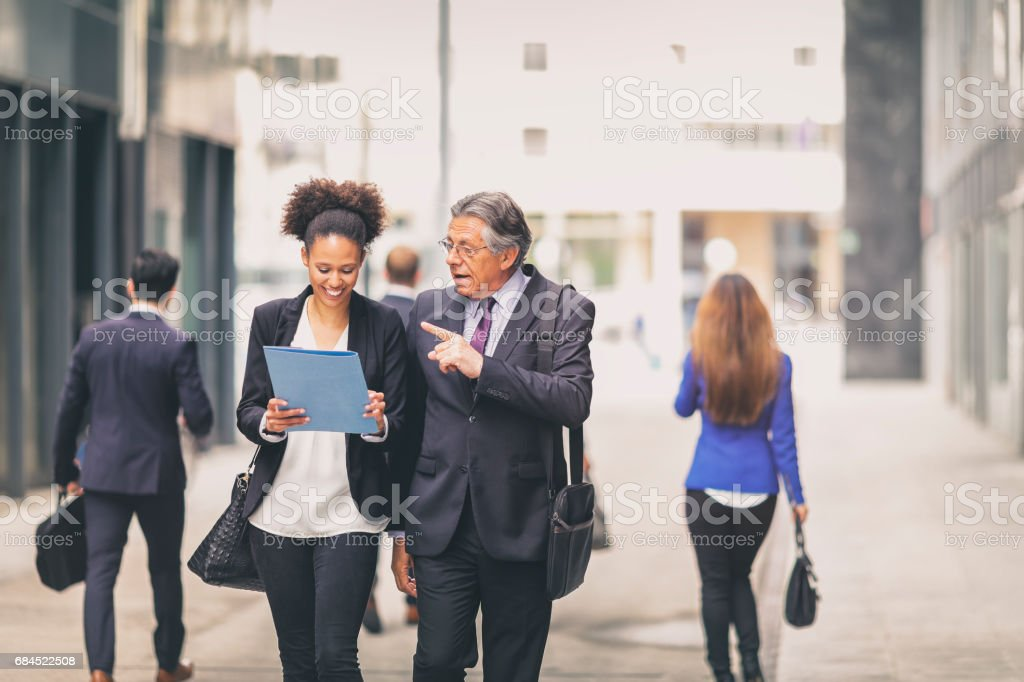 Student talking with a senior businessman stock photo