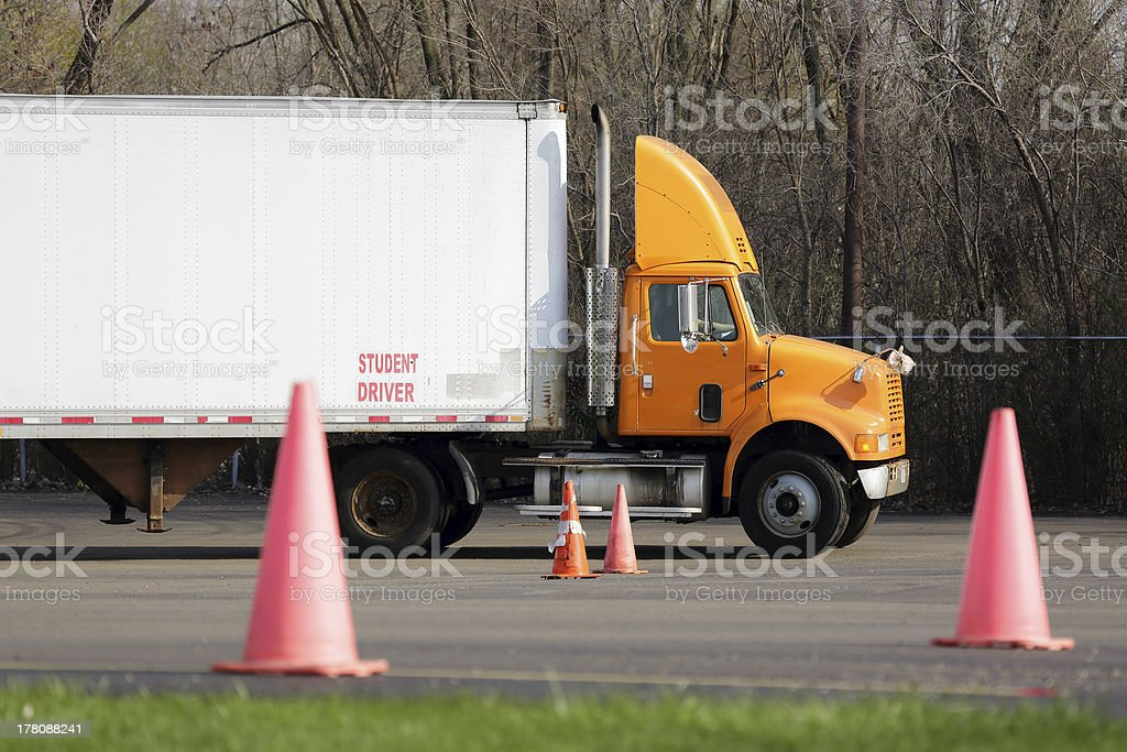 Student truck driver practices parking maneuvers stock photo