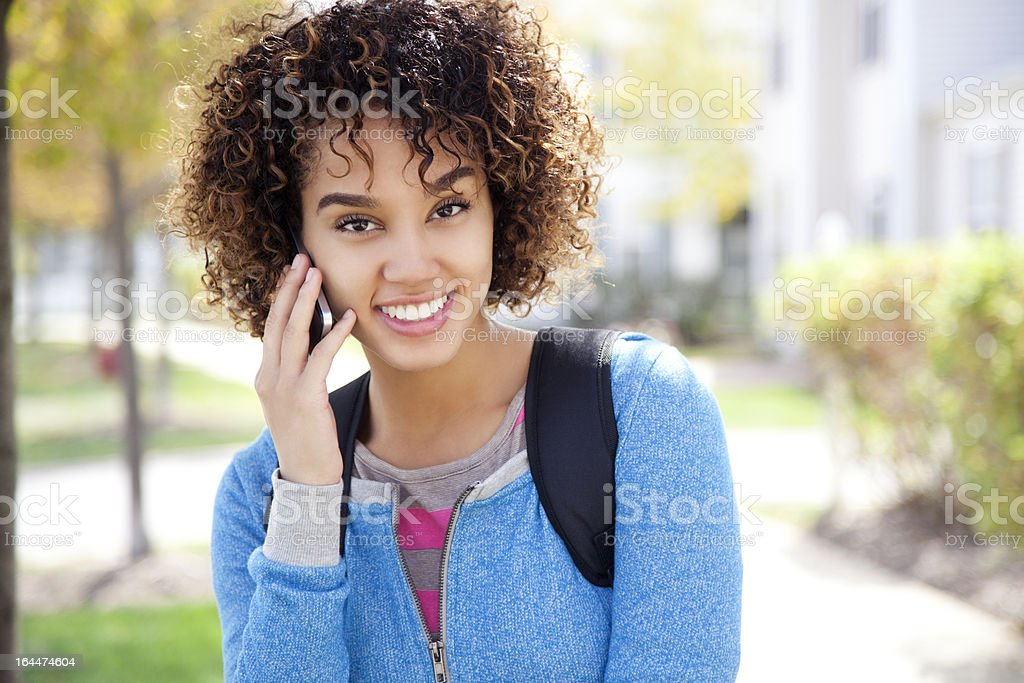 Student using a smart phone royalty-free stock photo