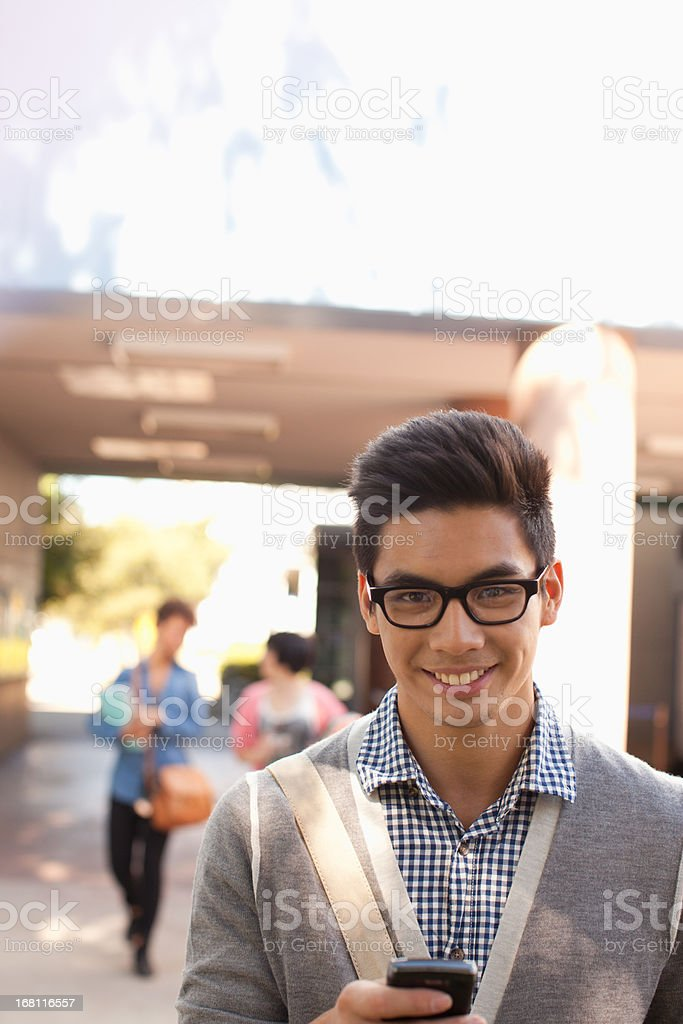 Student using cell phone stock photo
