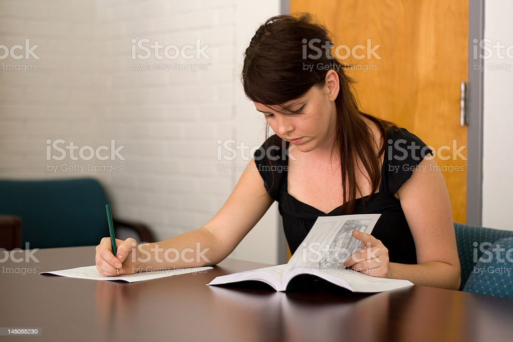 Student Using College Catalogue royalty-free stock photo
