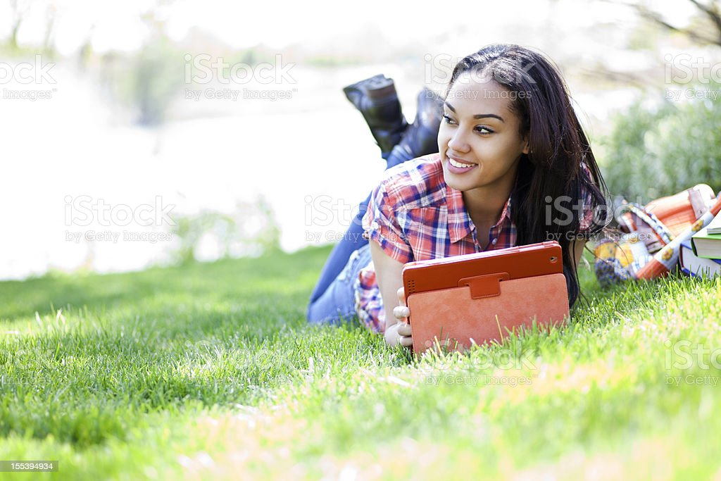 Student using digital tablet royalty-free stock photo
