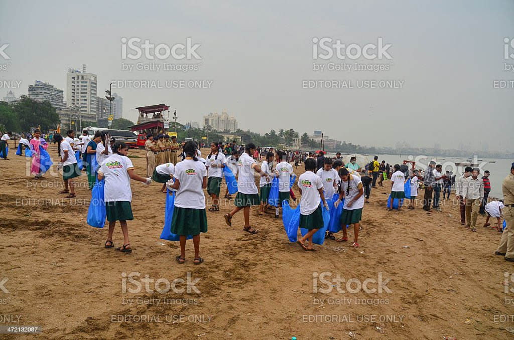Student volunteers helping to clean up the beach royalty-free stock photo