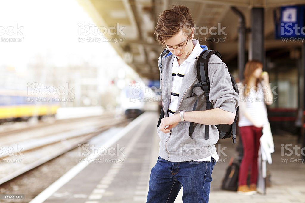student waiting for the train royalty-free stock photo