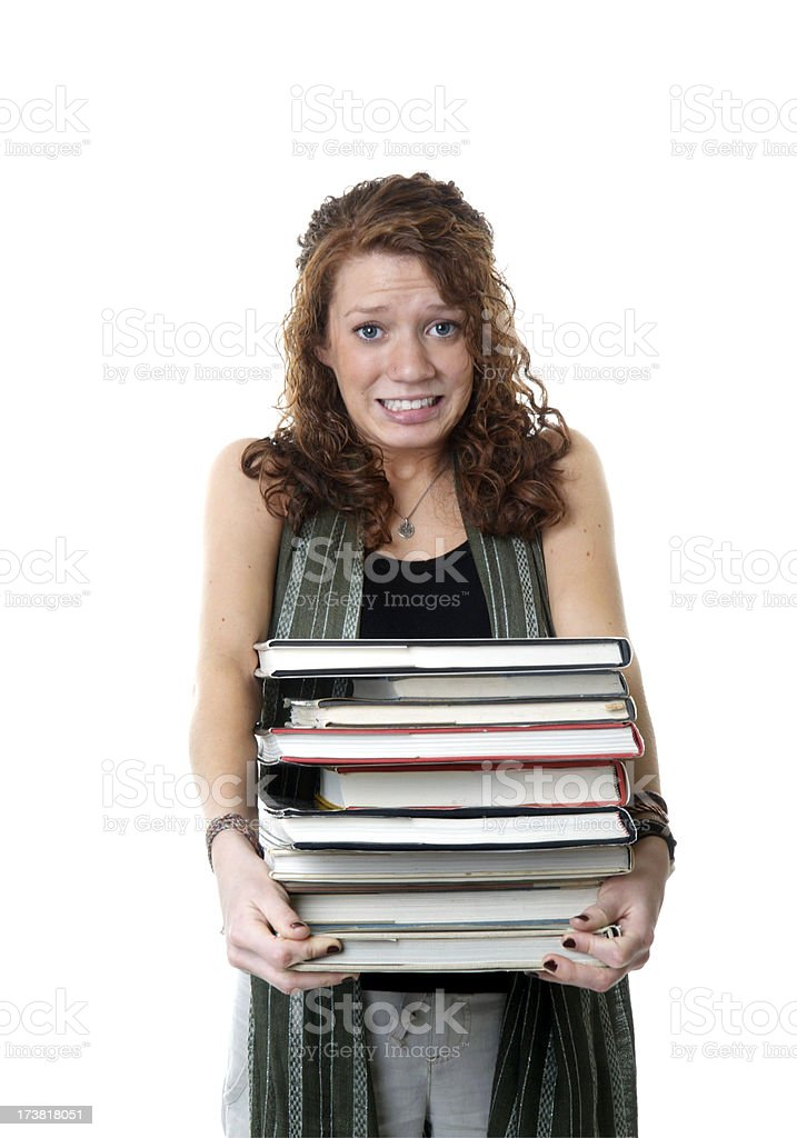 Student with a Heavy Load of Books royalty-free stock photo