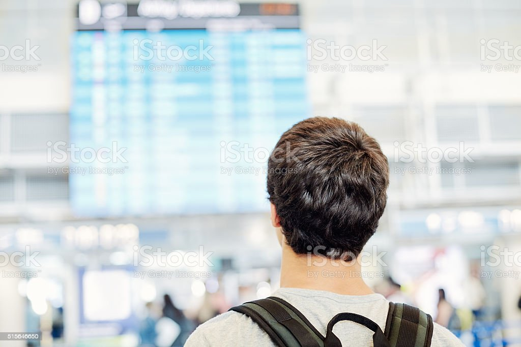 Student with backpack in airport stock photo