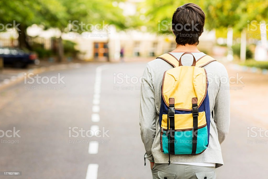 Student With Backpack Walking On Street stock photo