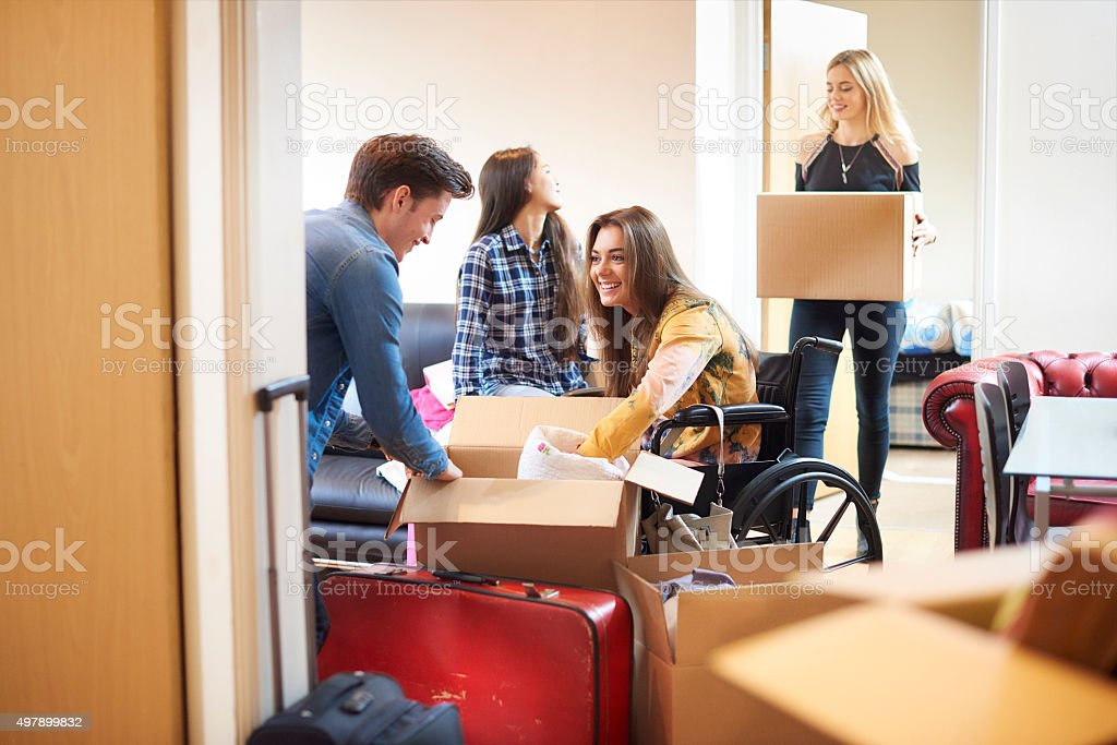 student with disability and housemates moving into halls stock photo