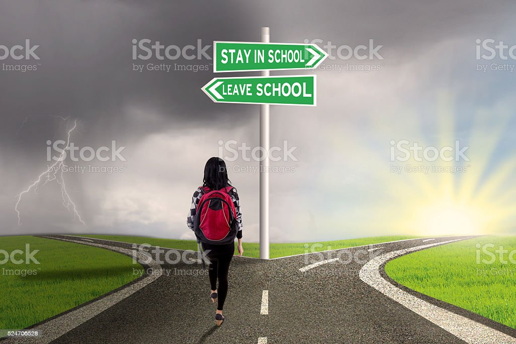 Student with guide to stay or leave school stock photo