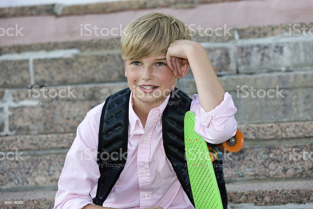Student with his skateboard stock photo