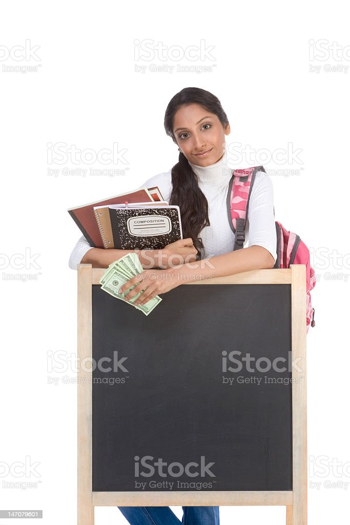 A student with money and chalkboard showing student loans stock photo