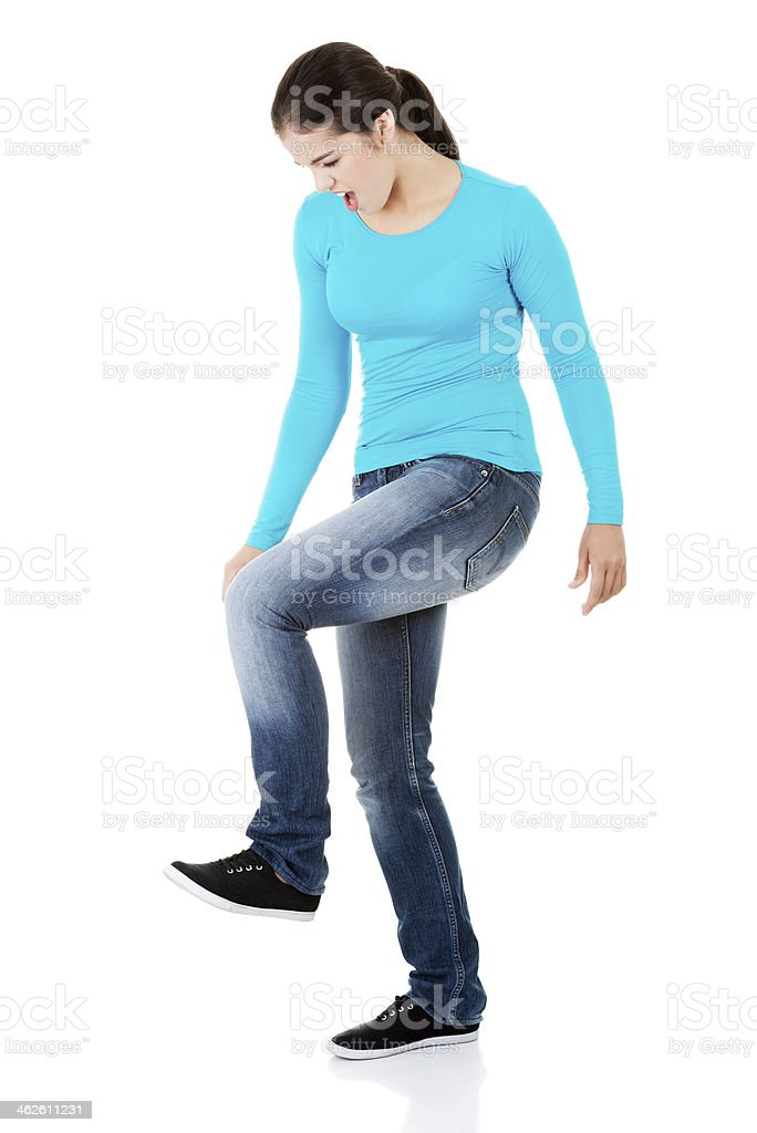 Student woman trying to trample something stock photo