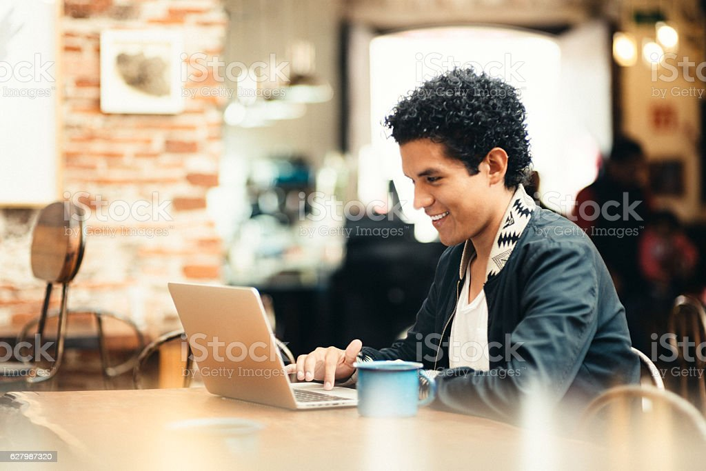 Student Working in Coffeeshop stock photo