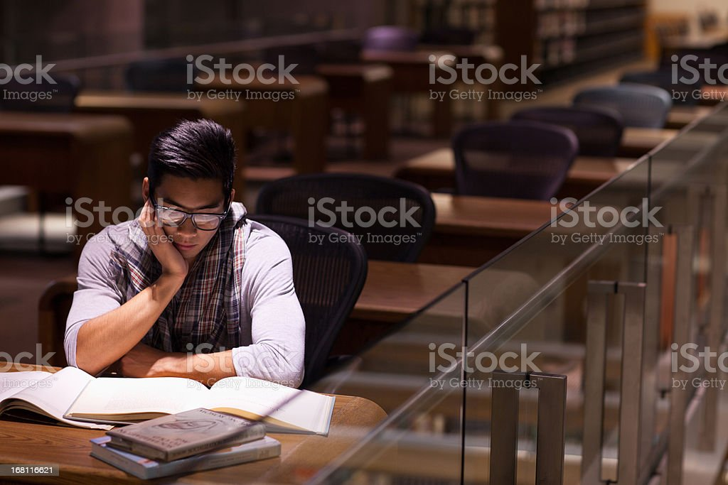 Student working in library stock photo