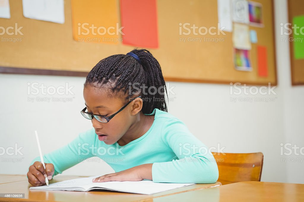 Student working on class work stock photo
