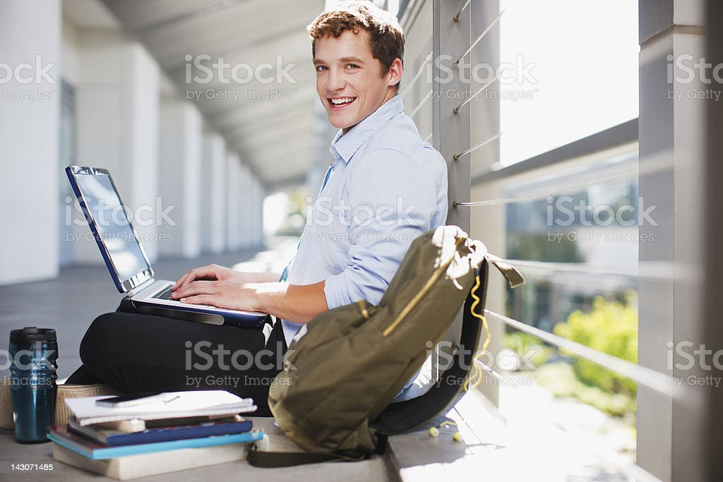 Student working on laptop on floor royalty-free stock photo