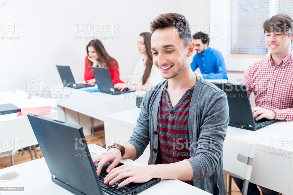 Student working on laptop PC in college stock photo