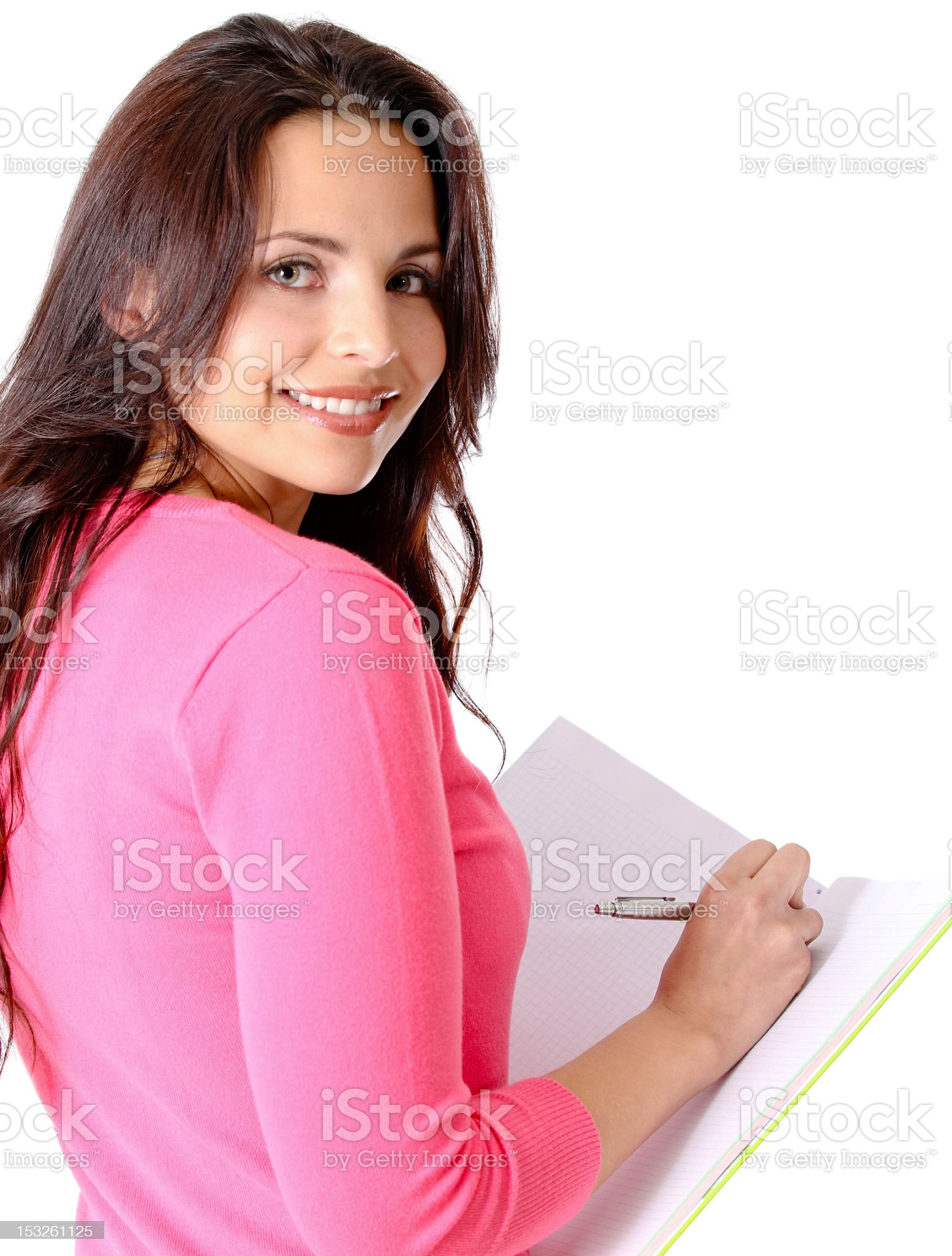 Student writing on a notebook royalty-free stock photo