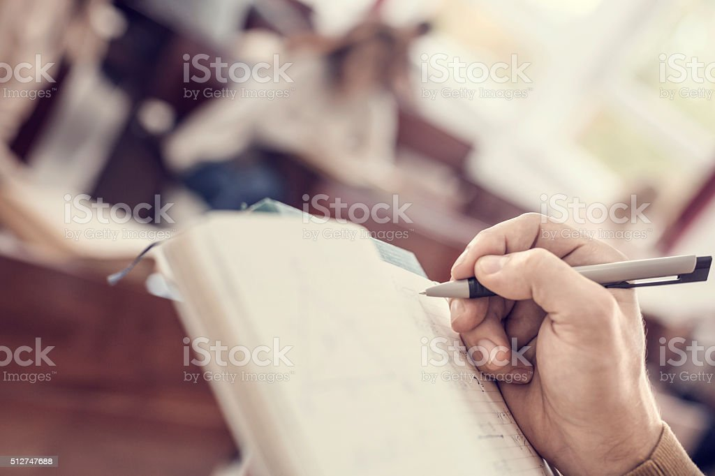 Student writing stock photo