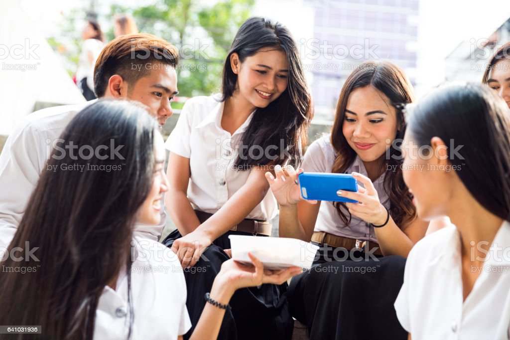 Students at lunch break eating take away food stock photo