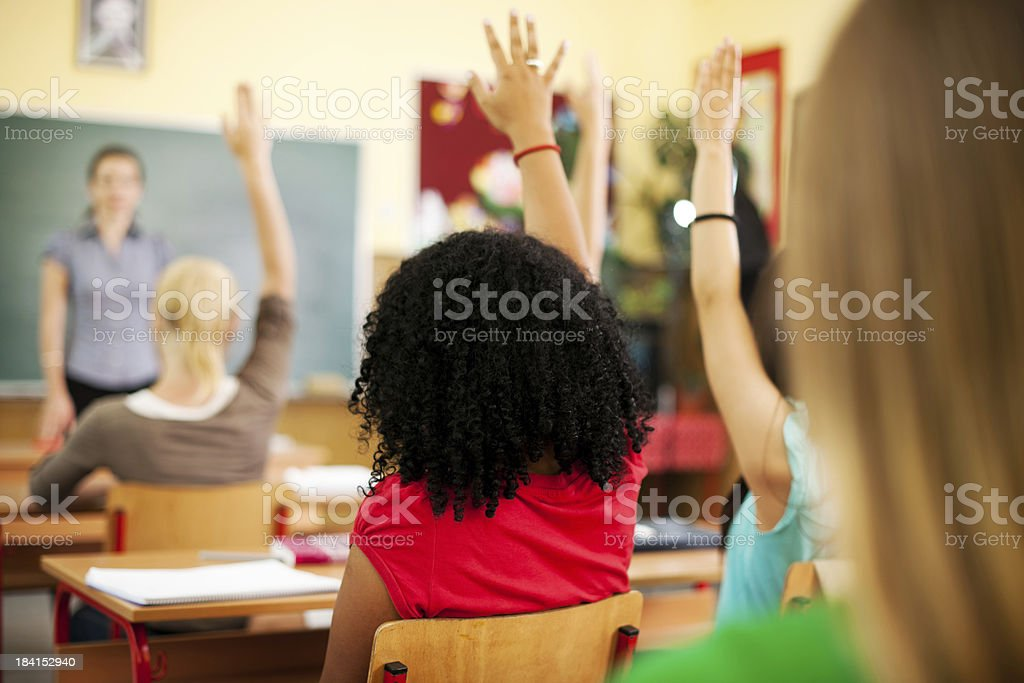 Students at the classroom answering questions. royalty-free stock photo