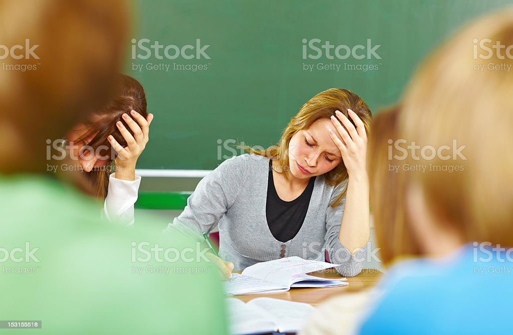 Students at the desk with notebook stock photo