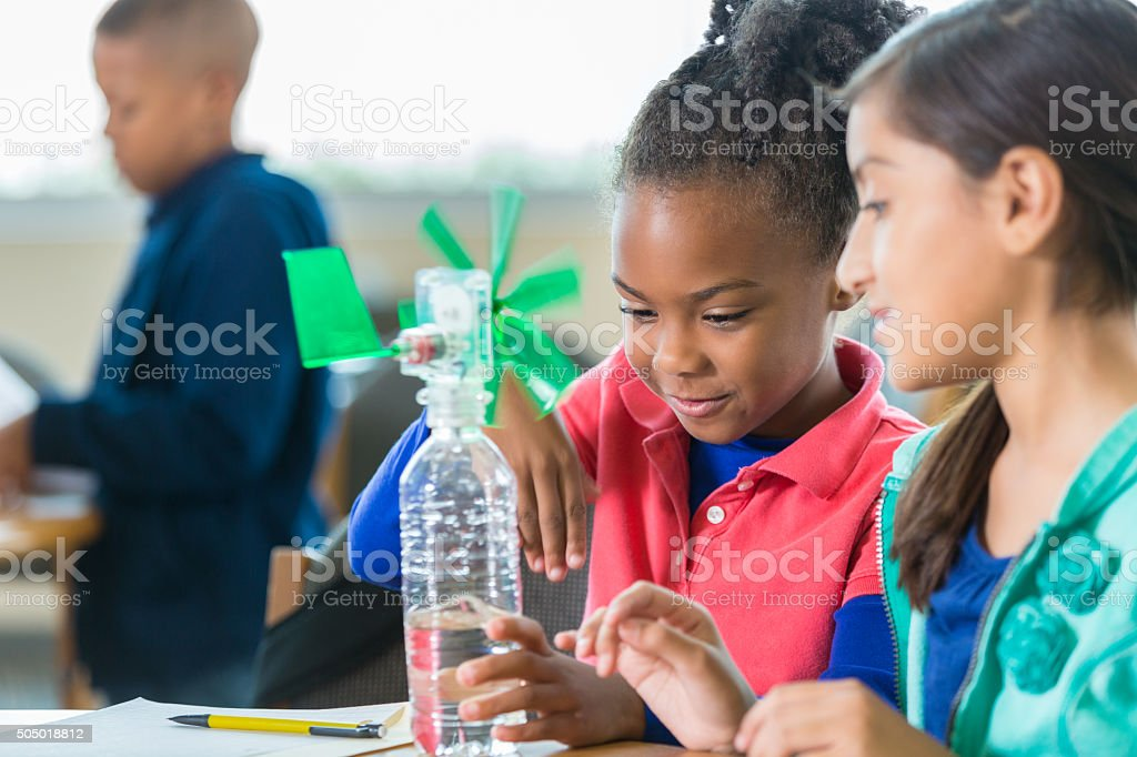 Students building windmill during elementary science class stock photo