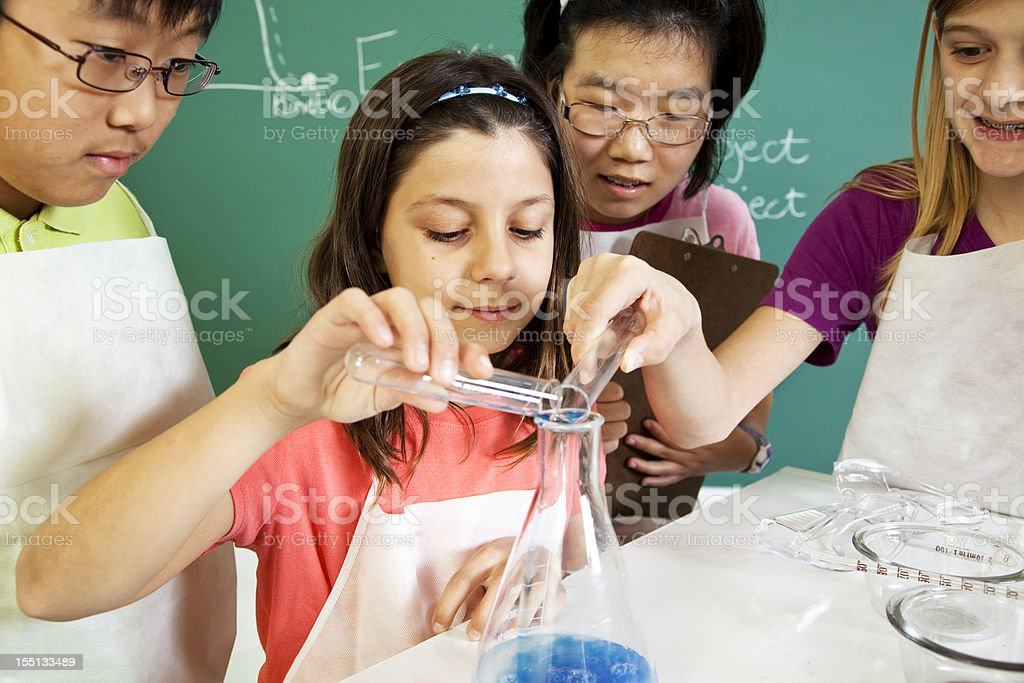 Students, children in school science biology lab, classroom mixing chemicals. royalty-free stock photo