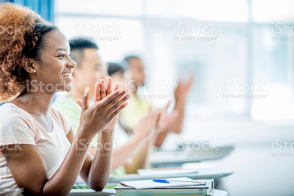 Students Clapping After a Lecture stock photo