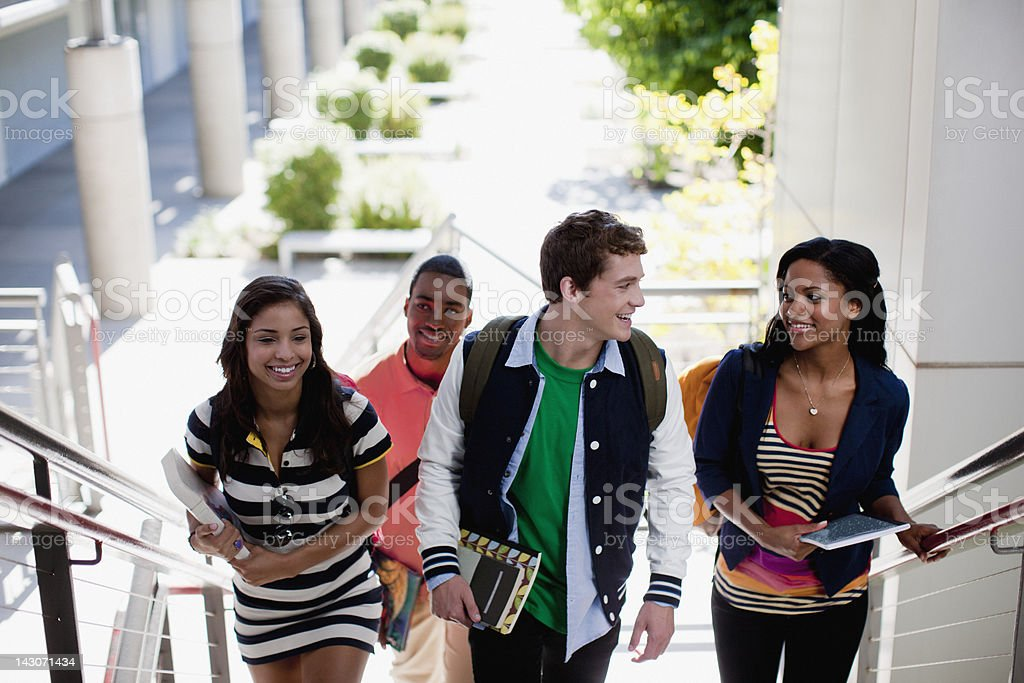 Students climbing steps together royalty-free stock photo