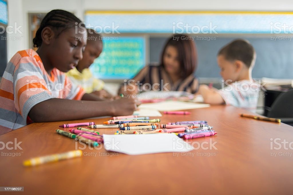 Students coloring at inner city school stock photo