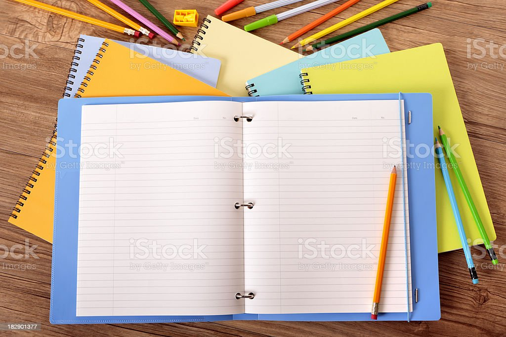 Student's desk with blue project folder stock photo