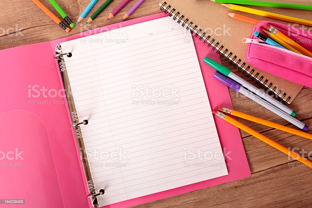 Student's desk with notebook binder and writing utensils royalty-free stock photo