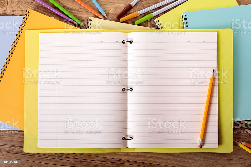 Student's desk with yellow project folder stock photo