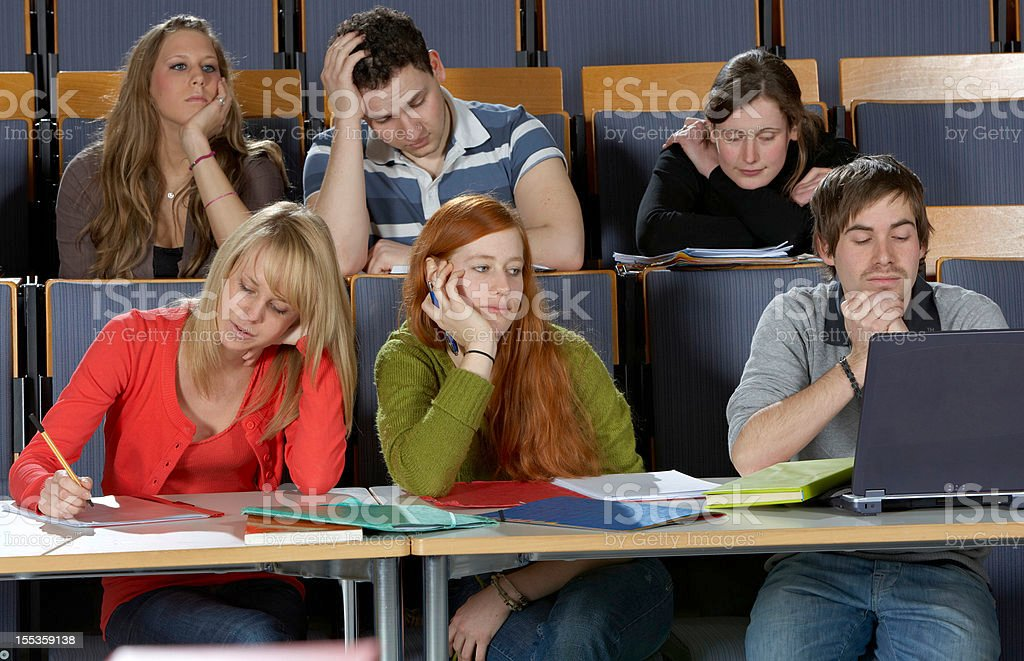 Students during a boring lecture royalty-free stock photo