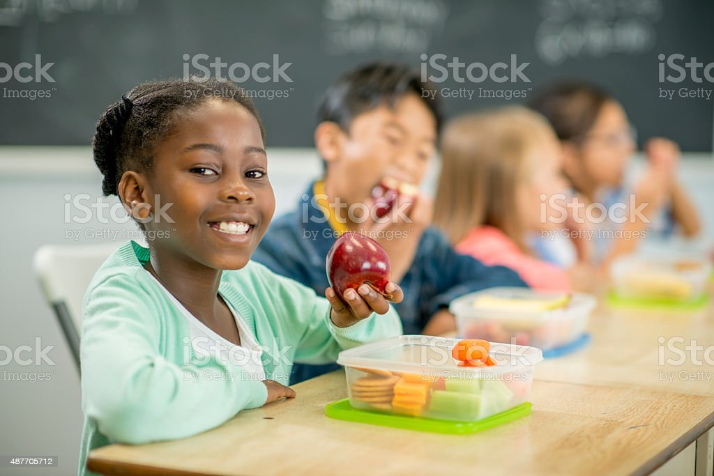 Students Eating a Healthy Lunch stock photo
