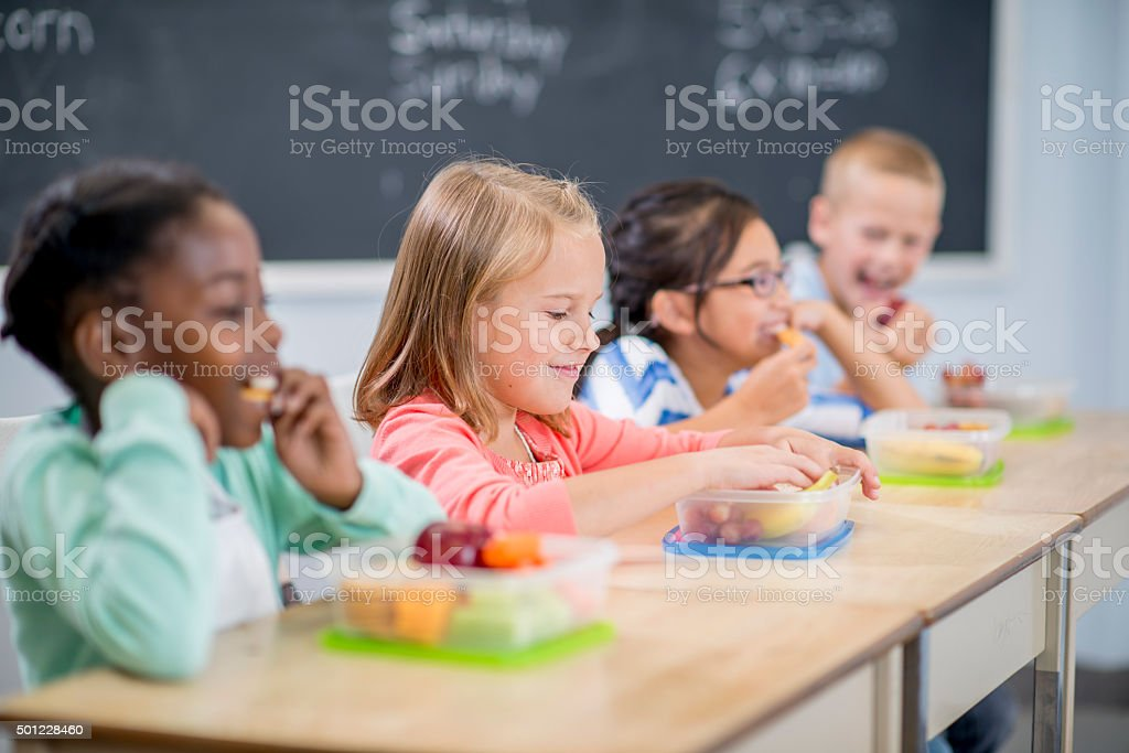 Students Eating Snacks at School stock photo
