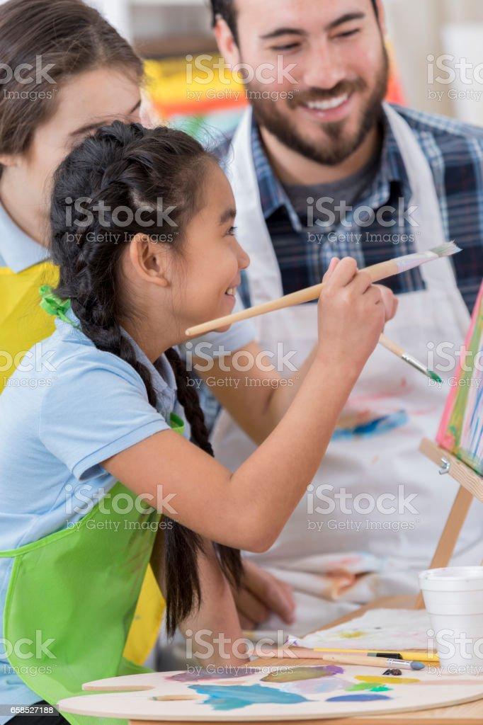 Students enjoying art class stock photo