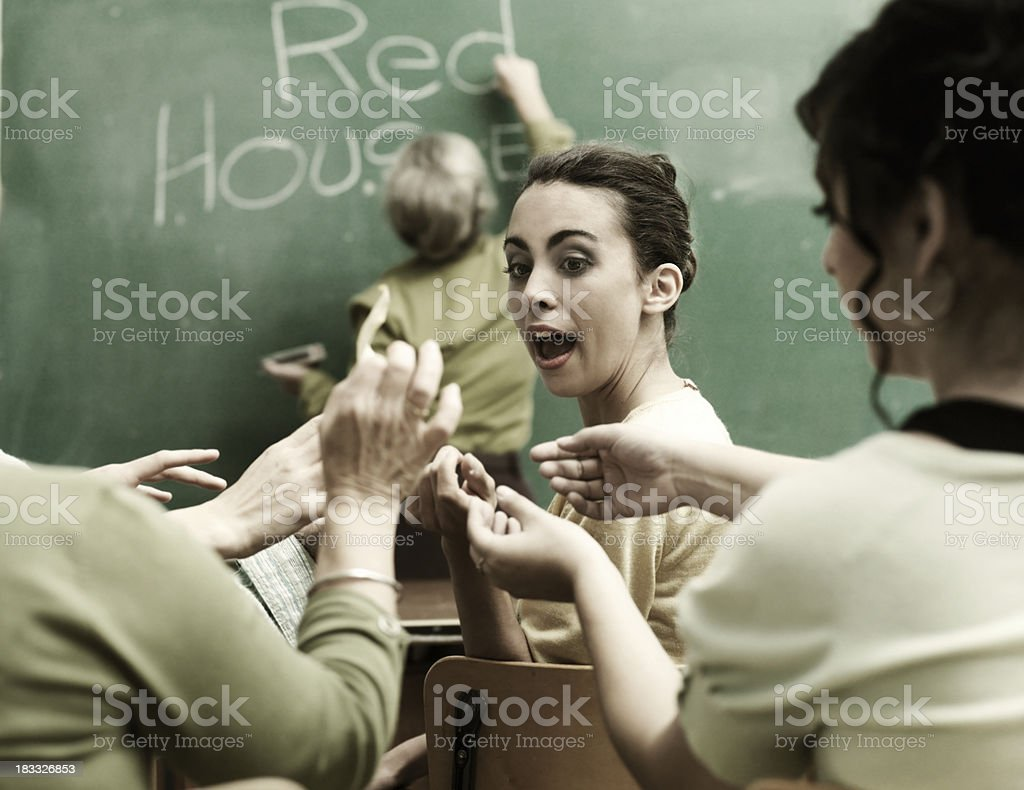 Students exchanging paper royalty-free stock photo