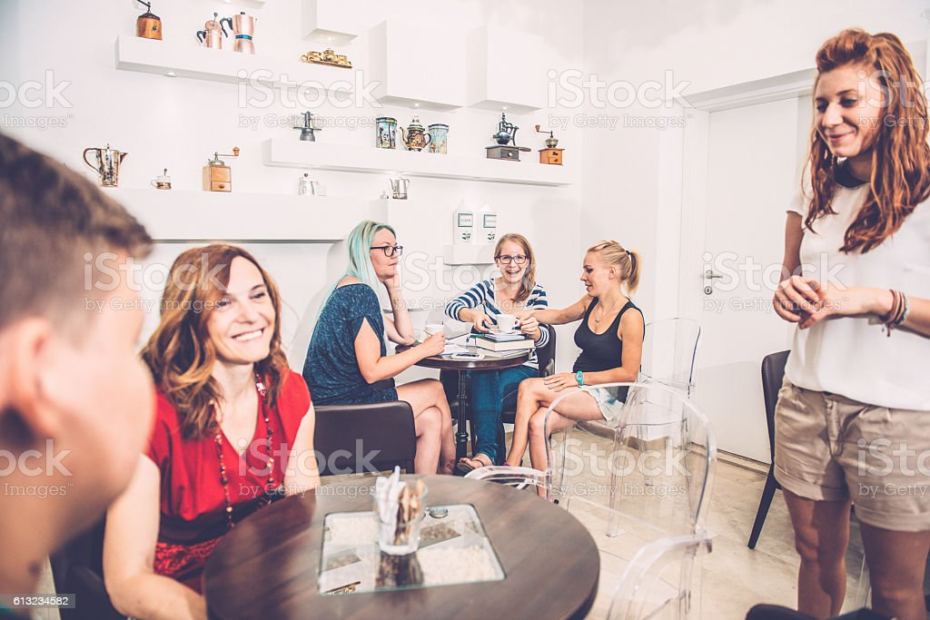 Students, Family and Barista at Coffee Bar Cafe Trieste, Europe stock photo