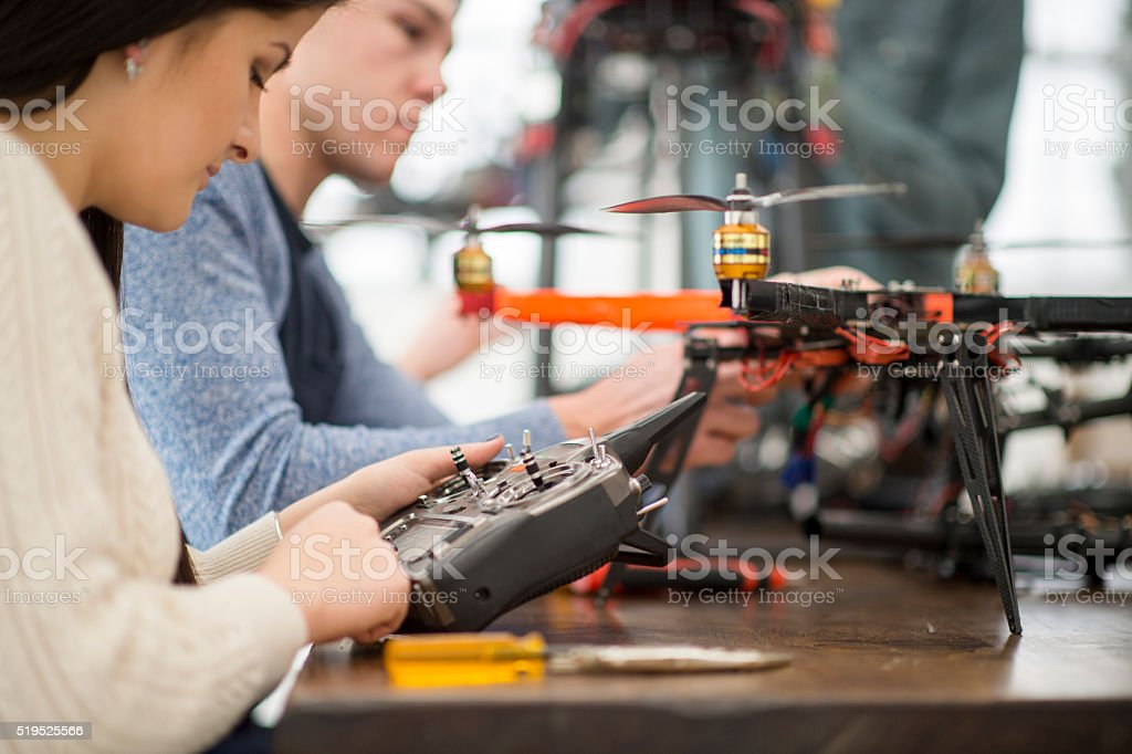 Students Fixing a Mechanical Drone stock photo