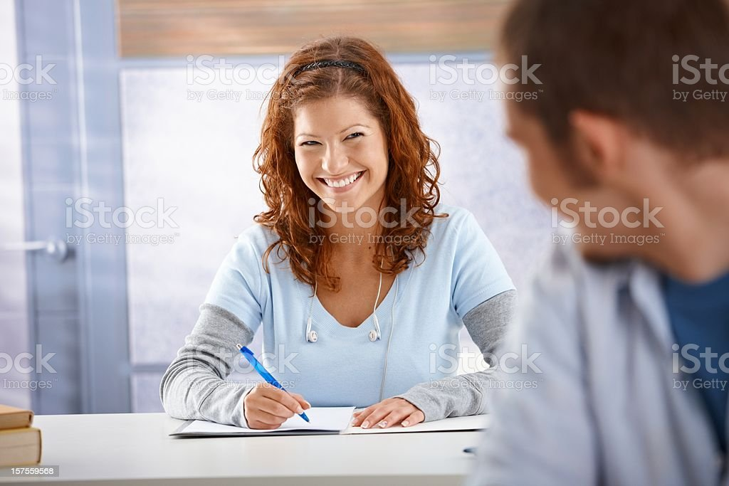 Students flirting in classroom royalty-free stock photo
