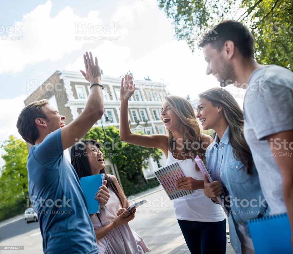 Students giving a high-five stock photo