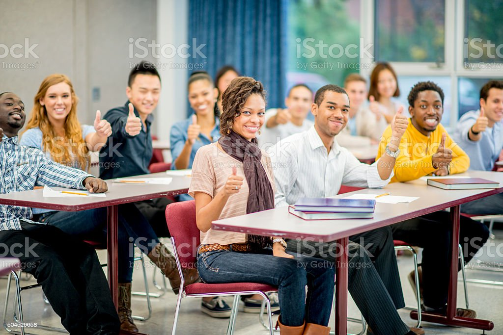 Students Giving Thumbs Up in Class stock photo