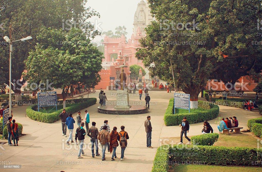 Students go to campus through park stock photo