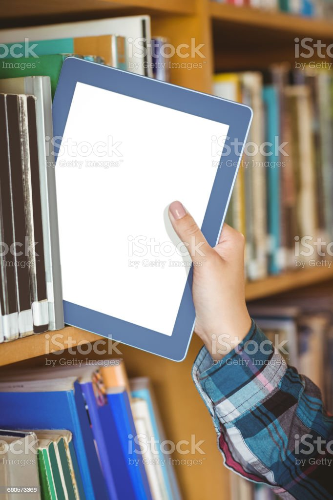 Students hand putting table in bookshelf stock photo