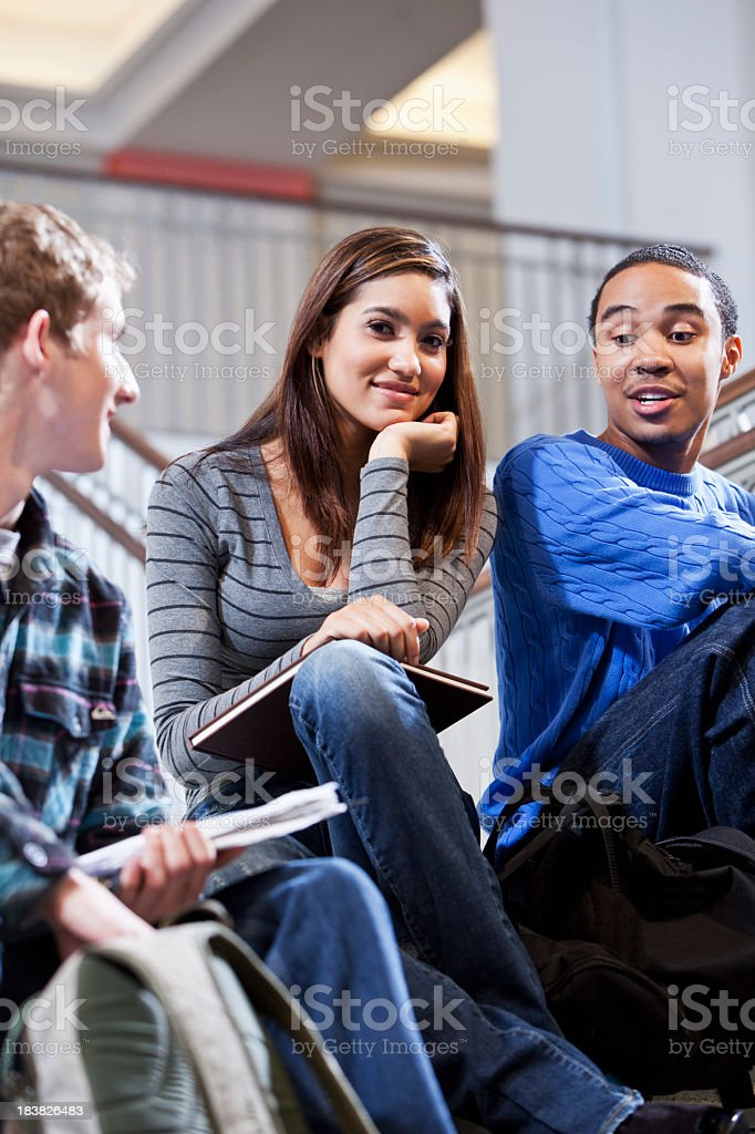 Students hanging out on stairs royalty-free stock photo