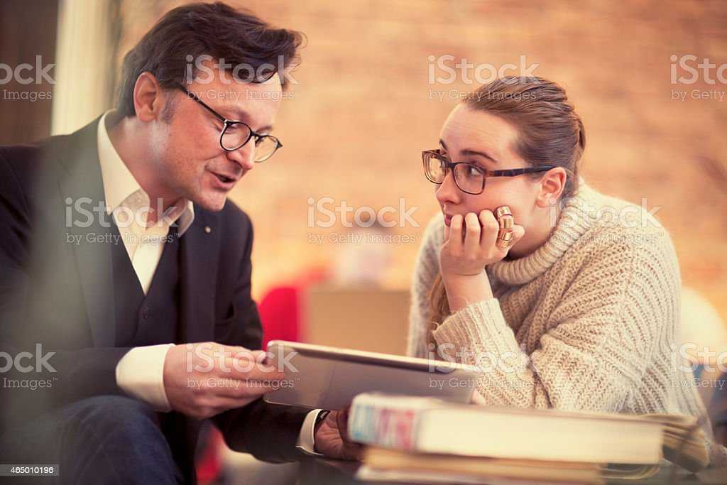 students  having   meeting at the coffee bar with proffessor stock photo