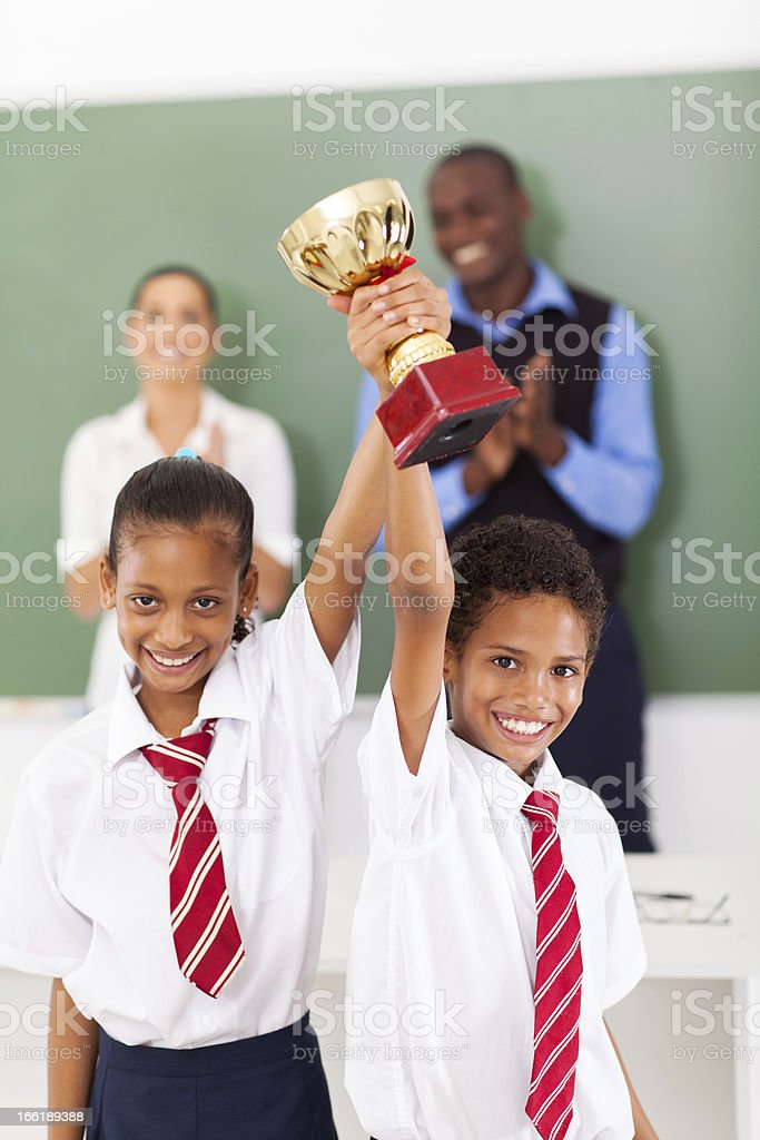 students holding a trophy stock photo