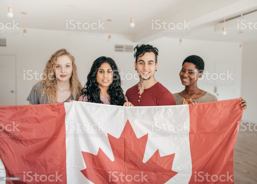 Students holding Canadian flag stock photo